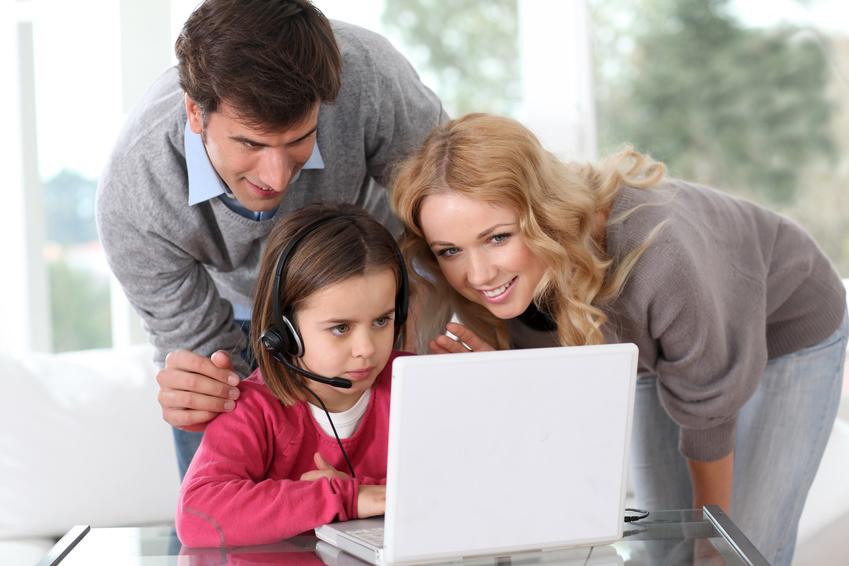 Family at home using computer webcamera
