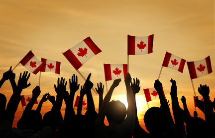 Au Pairs waving Canadian flags